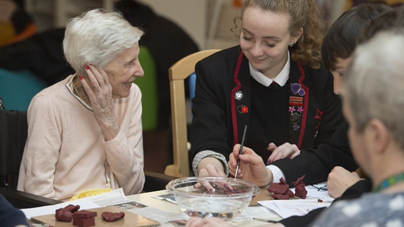 Whitburn academy pupil with woman from Whitdale Care Home