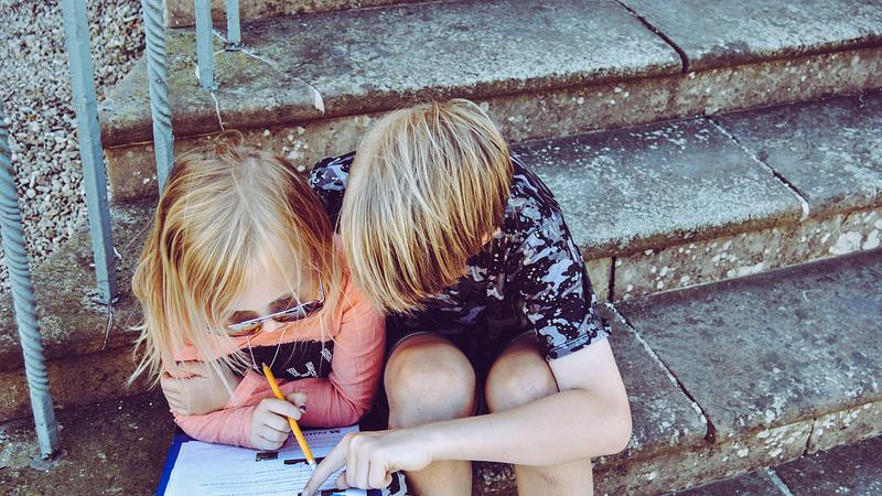 two children completing a learner attitude survey