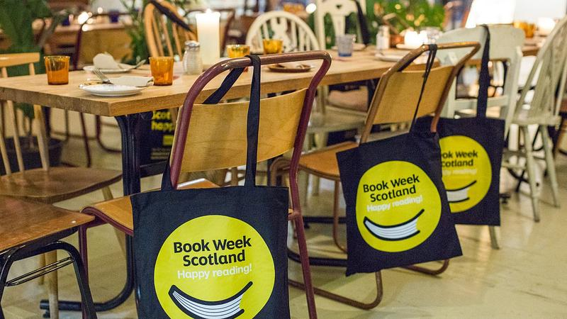 Book Week Scotland tote bags hanging over chairs