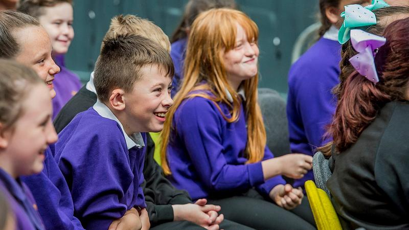 primary school pupils smiling and laughing